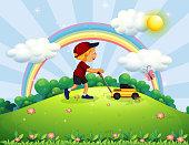 Boy pushing Lawn Mower the Garden
