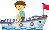 Boy sitting in the boat fixing his sock
