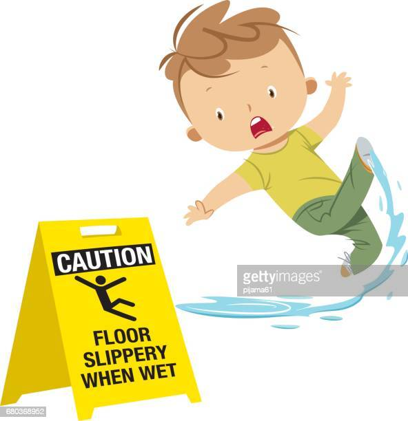 Boy slipping on wet floor