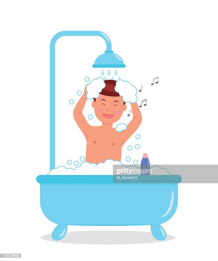 Boy taking a bath with soap bubbles.