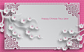 branches of cherry blossoms, oriental frame on pink pattern background for chinese new year greeting card, paper cut out style. Vector, caption chinese new year