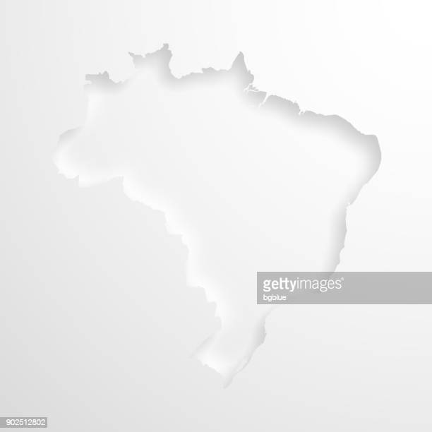 brazil map with embossed paper effect on blank background - craft product stock illustrations