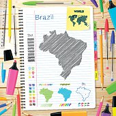 Brazil maps hand drawn on notebook. Wooden Background