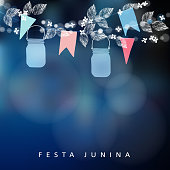 Brazilian June party, festa junina. String of lights, mason jar lanterns and paper flags. Midsummer garland of leaves and flowers. Party decoration. Birthday garden party. Blurred vector background