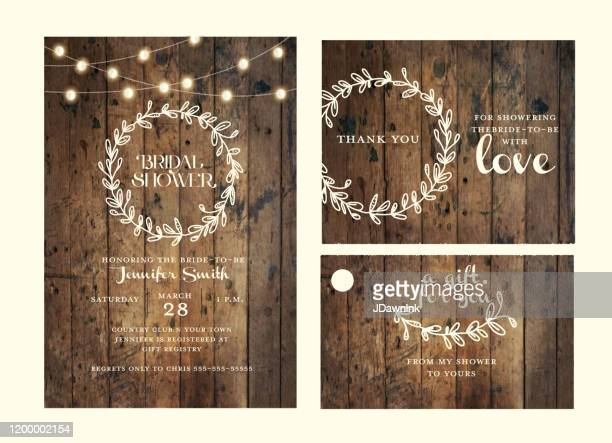 bridal shower design template set with hand drawn wreath and wooden background with string lights - rustic stock illustrations