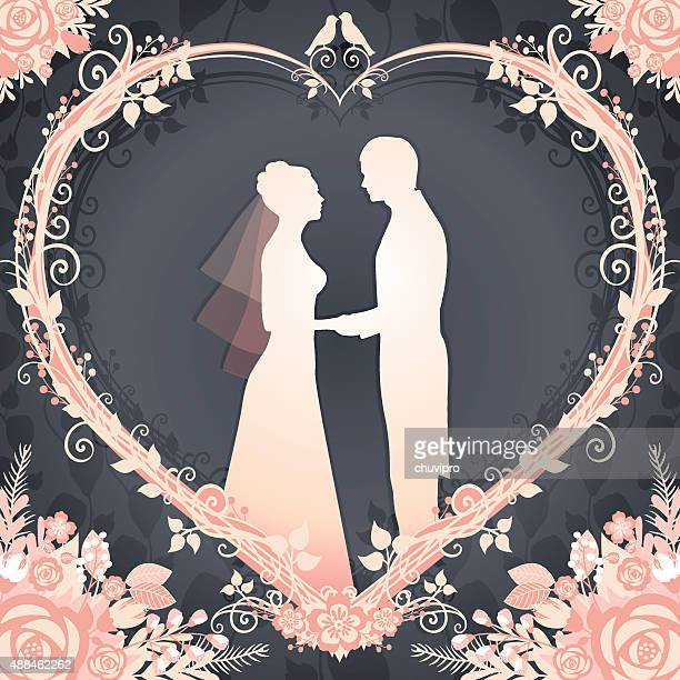 Bride and Groom framed in a floral wreath heart