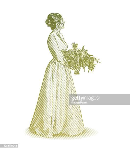 Bride, wedding dress and bouquet