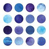 Bright blue watercolor spots background. Watercolour blots