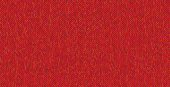 Bright knitted texture on red background.
