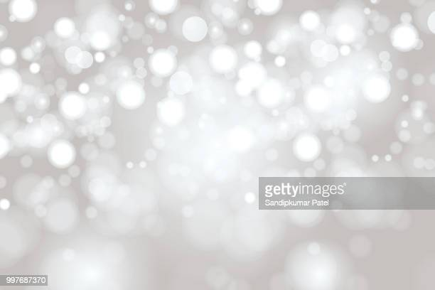 illustrazioni stock, clip art, cartoni animati e icone di tendenza di bright light grey high key bokeh dot background - festeggiamento