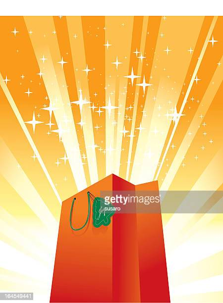 bright orange shopping bag surrounded by orange lights - goodie bag stock illustrations, clip art, cartoons, & icons