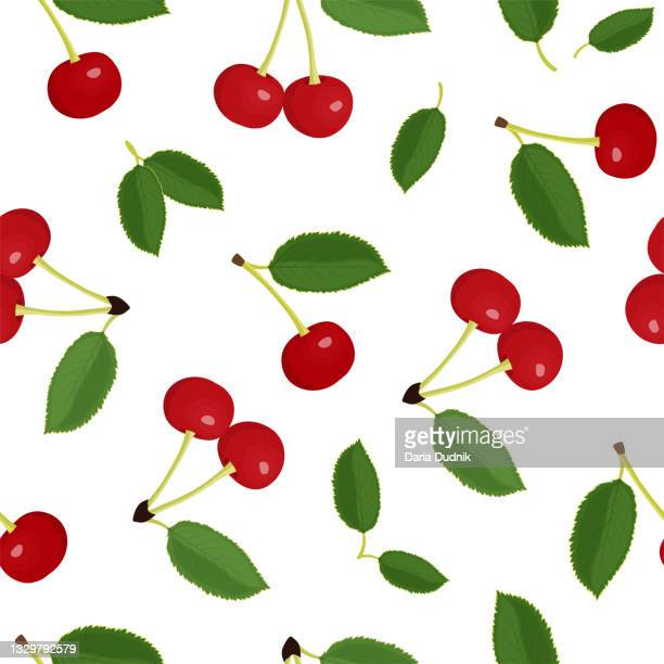 bright red cherries with green leaves