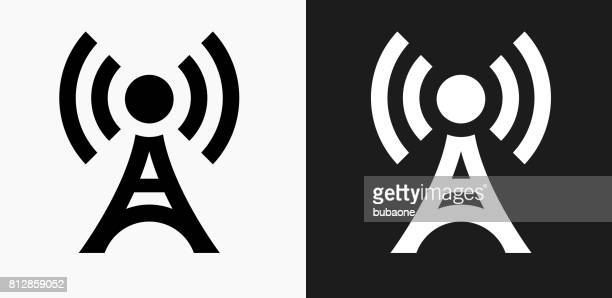 broadcasting tower icon on black and white vector backgrounds - communications tower stock illustrations