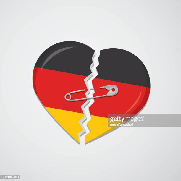 broken heart as german flag with safety pin - germany stock illustrations, clip art, cartoons, & icons