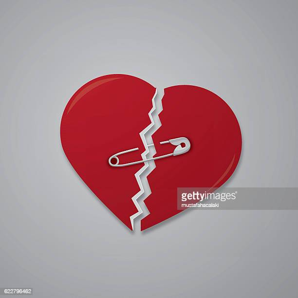 Broken heart attached with safety pin