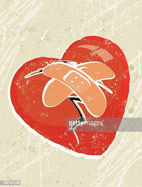 Coração partido Mended com emplastros