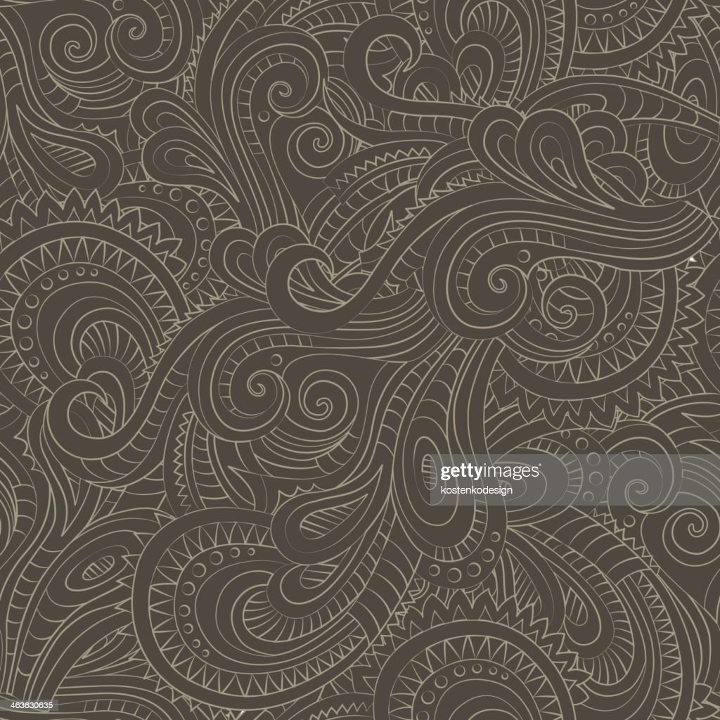 A brown and light brown decorative floral pattern