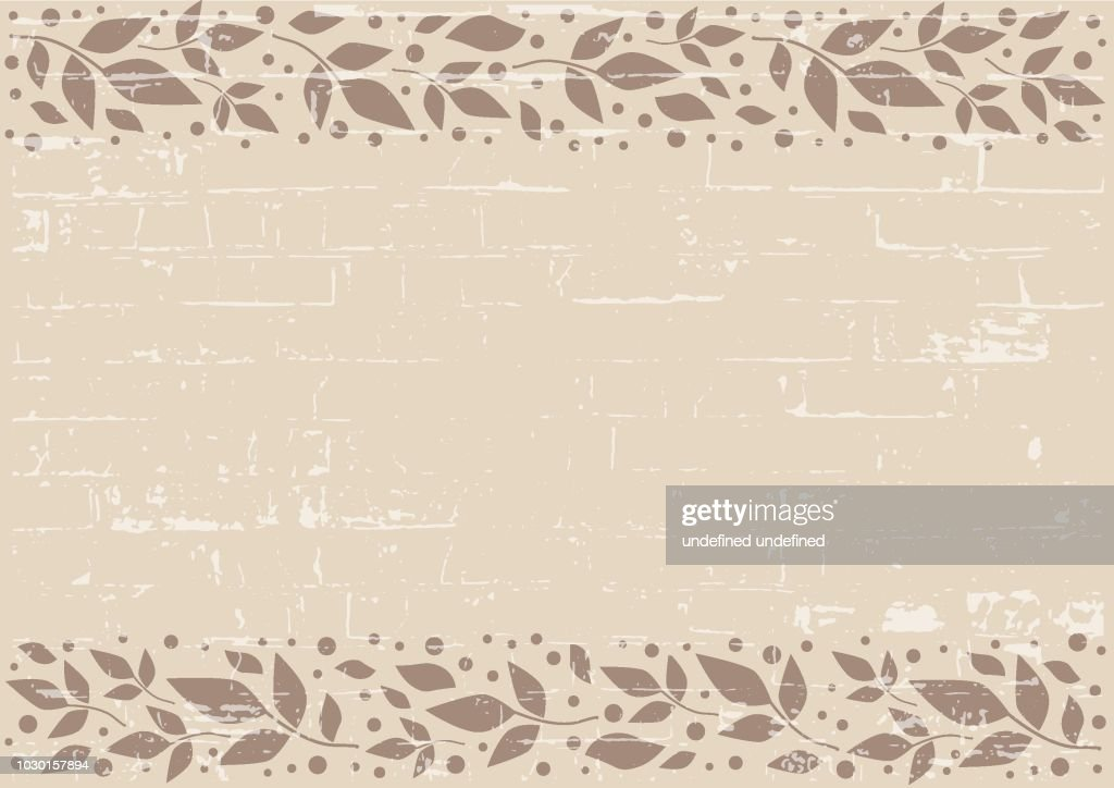 Brown background with decorative stripes align top and below with brown leaves and dots with texture