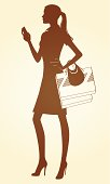 Brown cartoon picture of woman shopping