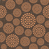 Brown dotted textured circles abstract background