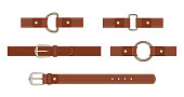 Brown leather belt with buttoned steel buckle, unbuttoned and with different metal haberdashery accessories