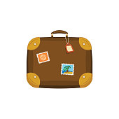 Brown travel bag suitcase with stickers, tag, label on isolated white background. Summer handle luggage. Travel concept.