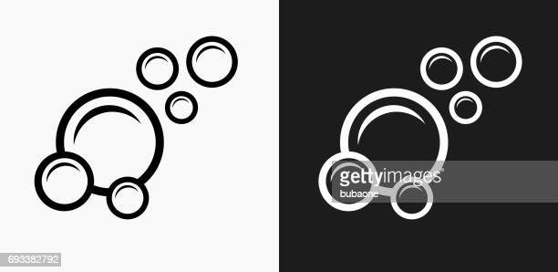 bubbles icon on black and white vector backgrounds - bubble stock illustrations