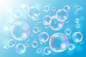 Bubbles soap on blue background.