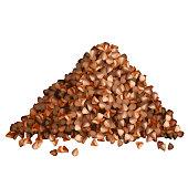 Buckwheat groats pile side view on white background