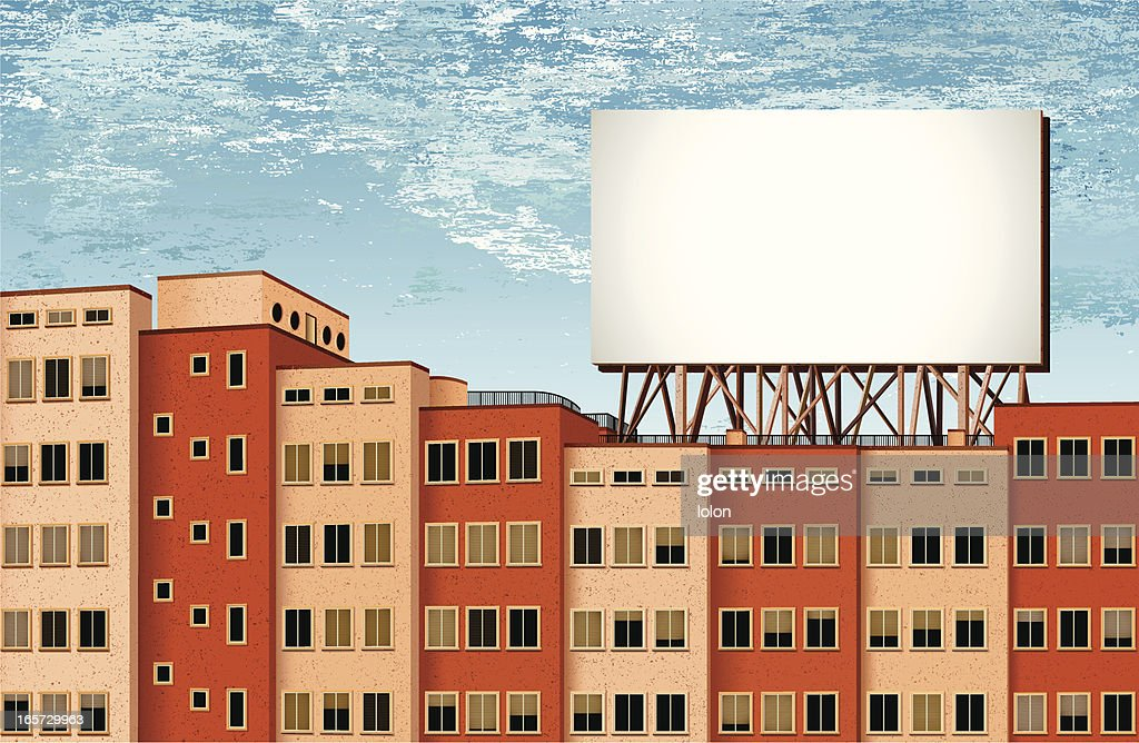 buildings and billboard with cloudy background