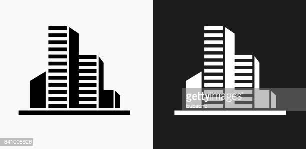 buildings icon on black and white vector backgrounds - skyscraper stock illustrations