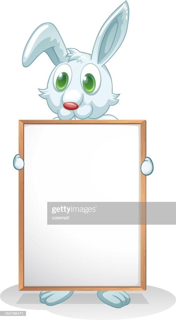 Coelhinho segurando um tabuleiro vazio : Arte vetorial