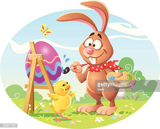 bunny painting easter egg - easter bunny stock illustrations