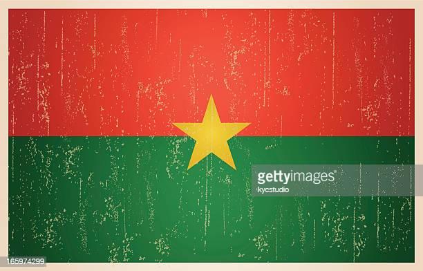 burkina faso flag in grunge and vintage style. - ouagadougou stock illustrations
