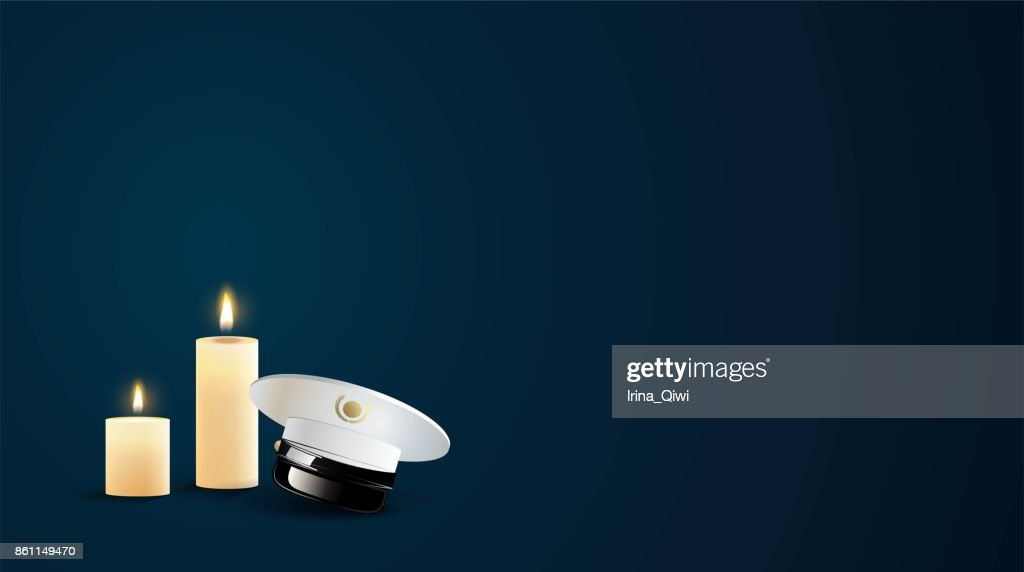 Burning candles and captain cap  in the dark.