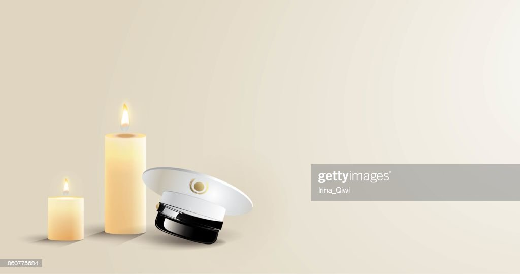 Burning candles and captain cap on white background.
