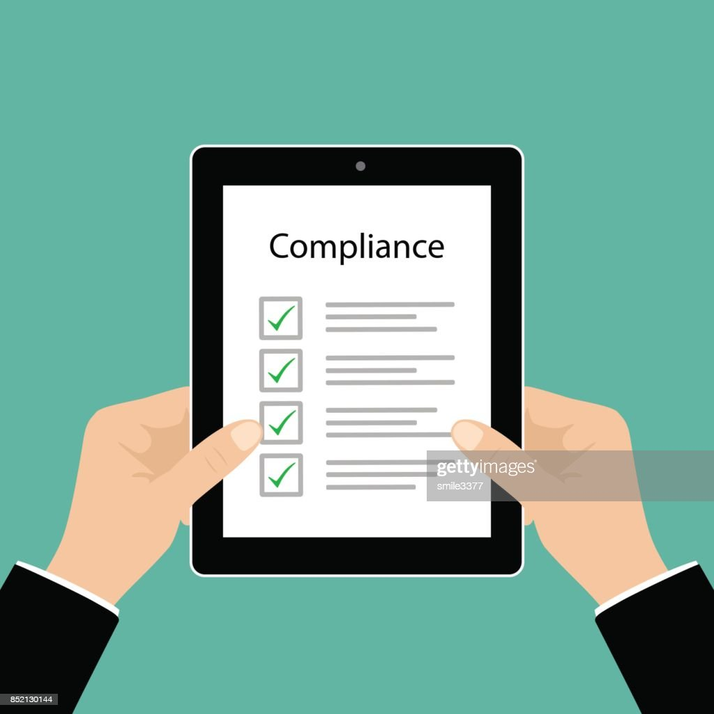 Business cocept. In Compliance Graphic with Tablet, businessman hand and tick marks