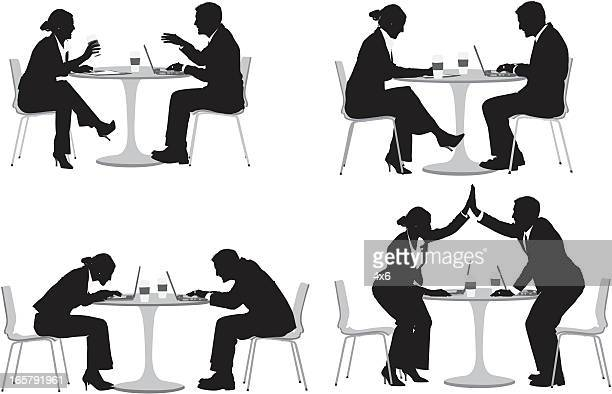 Business couple sitting in a restaurant