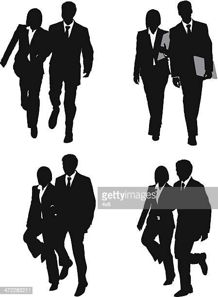 Business couple walking and skipping
