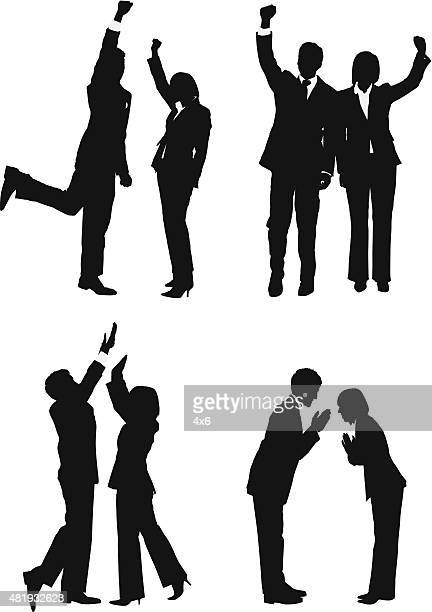 Business couples cheering