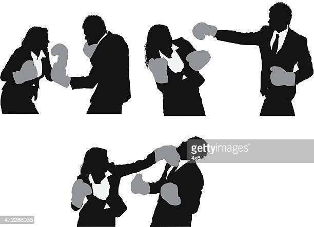 Business executives boxing