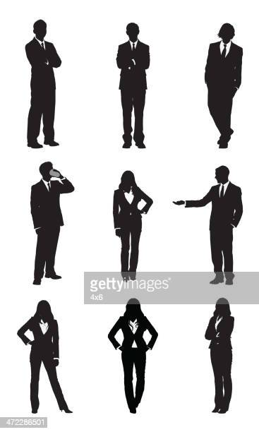 Business executives standing in different poses