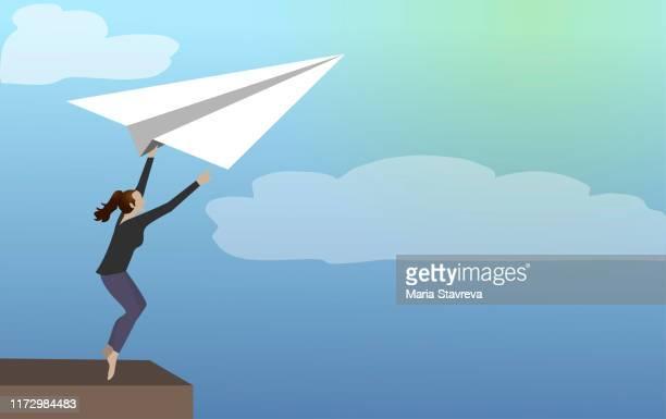 business leader verlässt komfortzone auf einem papierflugzeug. - neu stock-grafiken, -clipart, -cartoons und -symbole