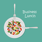 Business lunch concept. Plate with salad on a green background