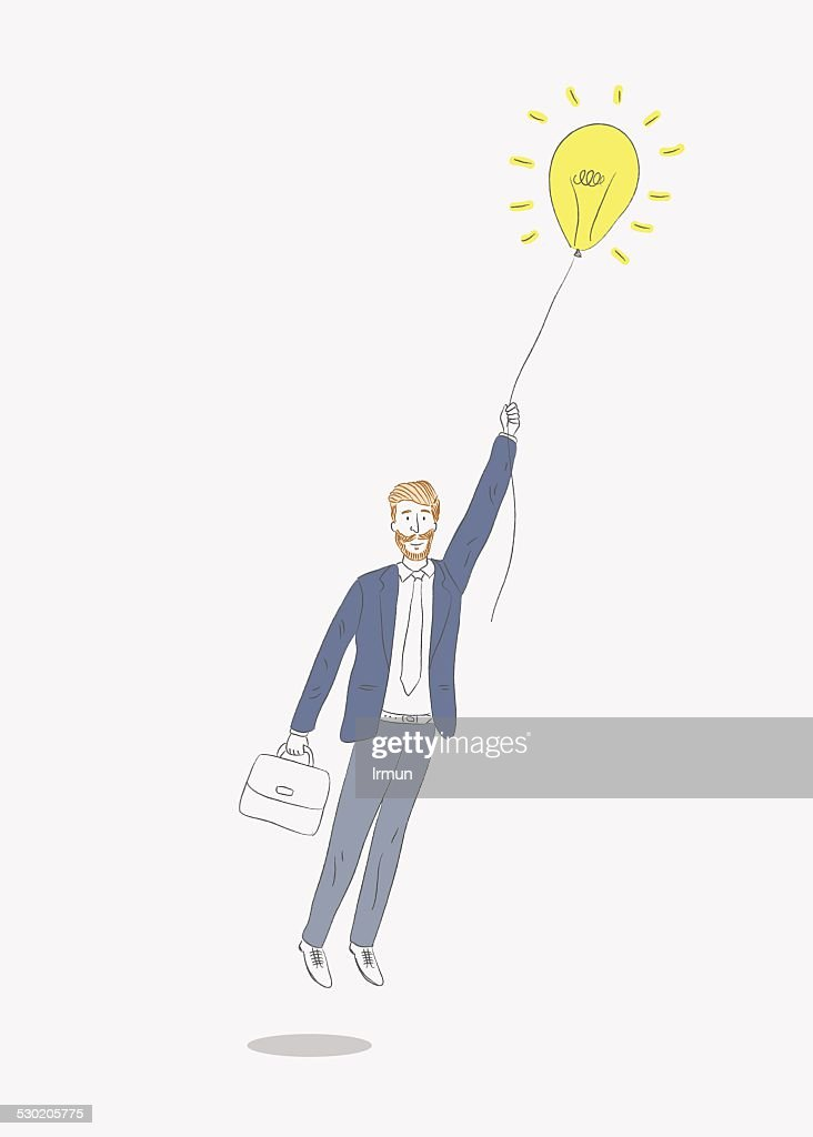 Business man flying with air balloon light bulb