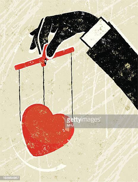 business man holding a heart puppet - puppet stock illustrations, clip art, cartoons, & icons