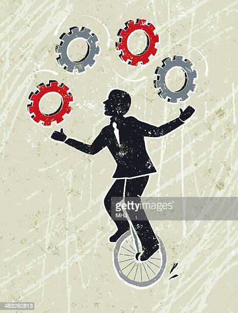 Business Man Juggling Cog Wheel Gears Whilst Riding a Unicycle