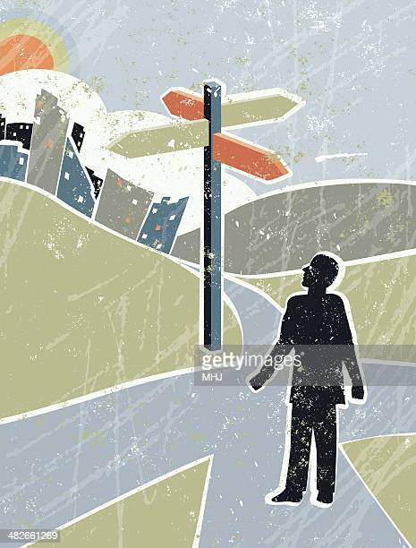 business man looking at road sign in countryside, crossroads - crossing stock illustrations