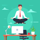 Business man meditating in lotus pose over table in office room. Boss doing yoga and get calm at workplace.