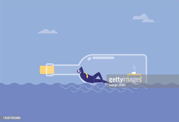 a business man rests in a drifting bottle and floats in the sea - driftwood stock illustrations